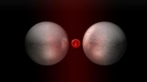Квантовый источник света, расположенный между двумя металлическими наночастицами. (кликните картинку для увеличения)